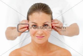 Charismatic woman having a head massage