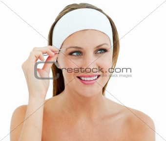 Charming woman using tweezers