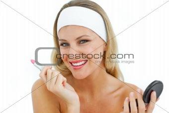 Beautiful woman holding a lipstick