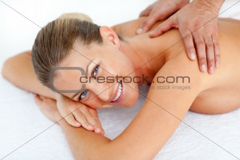 Charming woman receiving a back massage