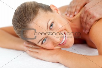 Portrait of smiling woman enjoying a massage