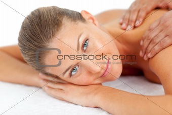 Portrait of blond woman enjoying a massage
