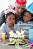 Cute little girl and her family celebrating her birthday