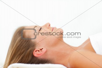 Portrait of joyful woman relaxing after a spa treatment