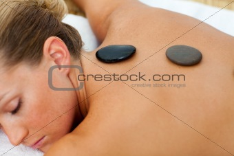 Asleep woman getting spa treatment