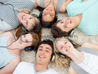 Group of teenagers listening to music