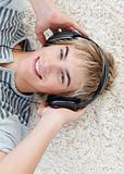 teen guy listening to music with headphones