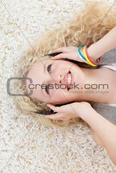 Beautiful teen girl listening to music