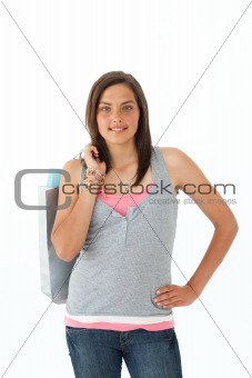 Beautiful teenager with shopping bags