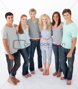 Group of friends standing against white background