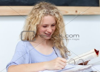 Blonde teenager doing homework