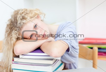 Blond teeenager sleeping in a library