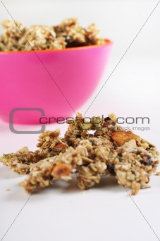 shot of gourmet granola in pink bowl vertical