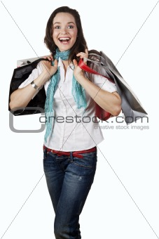 Beautiful, happy and laughing girl out shopping. Isolated on whi