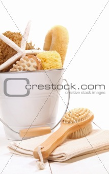 Bucket filled with sponges, scrub brushes and starfish