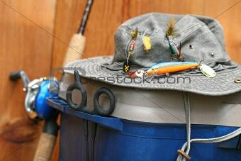 Closeup of fishing tackle box and hat