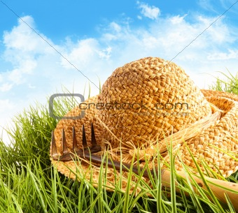 Straw hat on grass