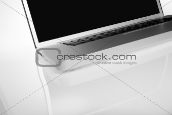 Modern silver laptop on white background