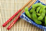 Bowl of edamame with chopsticks