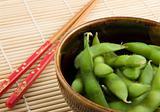 Bowl of edamame with chopsticks