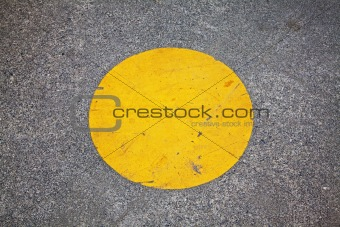 yellow circle on sidewalk