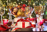  Holiday table setting with red ribboned gift