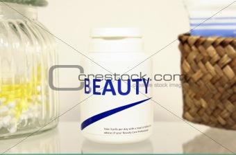 Beauty pills in a bottle on bathroom shelf