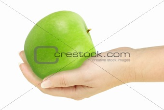Single green apple in a hand of woman