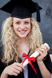 Portrait of a smiling teenage Girl Celebrating Graduation