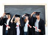 Group of teenagers celebrating after Graduation