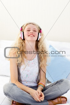 Beautiful teenager listening to the music
