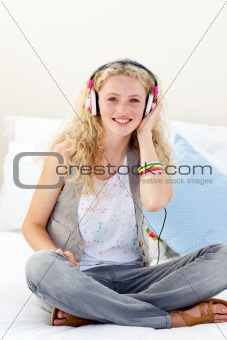Smiling teenage girl listening to the music