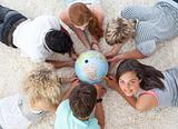 Group of friends on the floor examining a terrestrial world