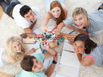 Group of Teenagers lying on the ground studying together