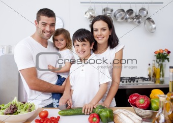 Smiling family cooking together