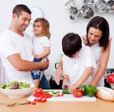 Young family cooking together in the kitchen