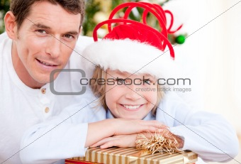 Bright father celebrating christmas with his son