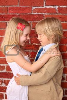 Little boy hugging a pretty girl.  Love concept. Background