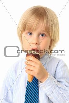 Little boy eating ice cream. Child isolated on white