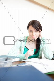 Charming teen girl studying