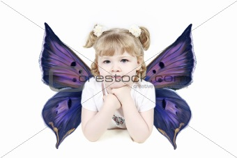 Adorable little girl with wings isolated on white background