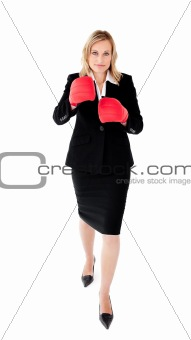 Ambitious businesswoman boxing