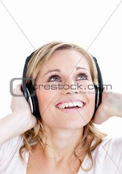 Portrait of happy girl listening to music on headphones