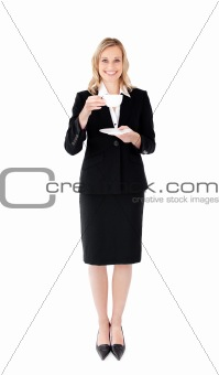 A happy businesswoman holding a cup of tea