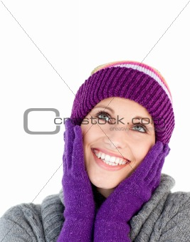 Bright woman with purple gloves and a colourful hat