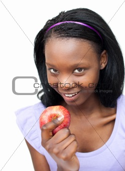 Attractive young woman eating an apple