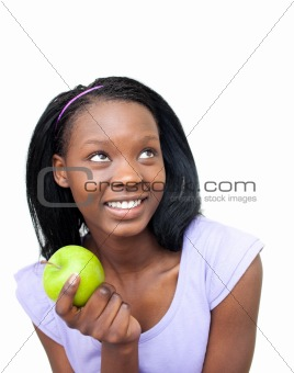 Cute young woman eating an apple