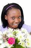 Cute young woman holding flowers