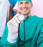 Attractive surgeon holding a stethoscope