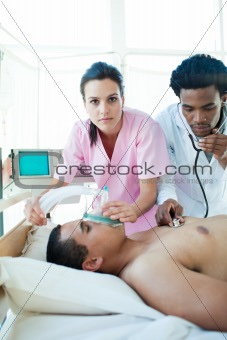 A doctor and a nurse resuscitating a male patient